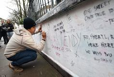 A well-wisher scribbles a message of thanks to the late Beatles producer Martin on the wall outside the famous Abbey Road Studios in London