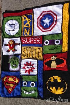 Crocheted Superhero Afghan. Each block was made by a different friend, then they stitched the whole thing together to give to a little boy with cancer. How awesome!