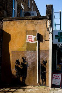 (´∀`)                                                               street art by Banksy