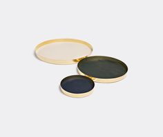 Karui trays by Skultuna. Designed by Danish-Italian duo GamFratesi in 2014, the Karui tray is a minimalist piece in brass, made using metal spinning, a classic Skultuna technique. The elegant round tray is slender and light, featuring a thin lip and a leather surface by leading Swedish tannery Tärnsjö. Shop it now at www.store.wallpaper.com