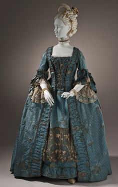 Woman's robe a la francaise, England, circa 1765. Silk plain weave (faille) with silk and metallic-thread supplementary-weft patterning (lamella or strip) trimmed with metallic lace.