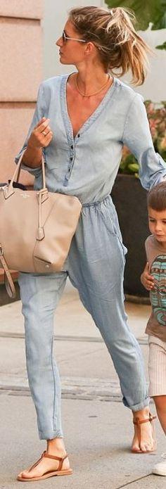 Who made  Gisele Bundchen's nude leather handbag, denim jumpsuit and brown flat sandals