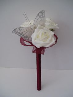 Artificial Ivory Roses wand with burgundy ribbon loops and silver sparkle butterfly.