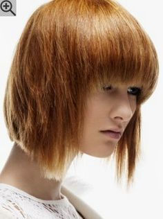 Razored bob haircut with bangs, a long back section and frontal points.