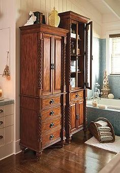 Handsomely store and organize your bath essentials in the statuesque Wakefield Full-height Cabinet that boasts carved mahogany construction and oil-rubbed brass hardware.