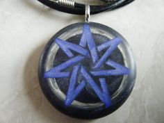 Heptagram / Fairy Star hand carved on a black pearl clay background. Pearl Background, Days Of Creation, Black Fairy, Seven Chakras, Christian Religions, Sacred Symbols, Pearl Grey, Leather Necklace, Wicca