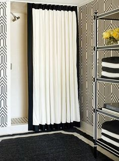 Black and White Bathroom. love the graphic pattern on the walls, but I would probably do this in white + a color instead :)
