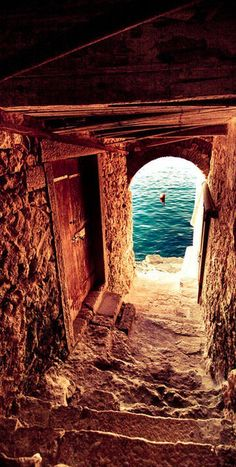 Passageway to the sea on the Isle of Crete, Greece • Note: a comment on Murray's webpage has this passageway in Rovinj, Croatia