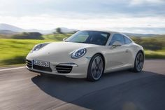 View 2013 Porsche 911 Anniversary Edition Coupe Photos from Car and Driver. Find high-resolution car images in our photo-gallery archive. Luxury Sports Cars, Sport Cars, Carros Porsche, Porsche Autos, Porsche Cars, My Dream Car, Dream Cars, Porsche 911 Carrera S, Germany