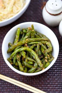 This is an easy and classic preparation for Chinese dry-fried green beans sauteed in soy, garlic and sesame oil. Tasty, salty, and tender dry-fried green beans - the best!