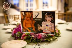 table numbers with pictures of bride and groom at that age