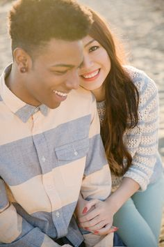 urban outfitters style engagement session pink cream blue and denim mixed race couple