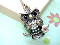 A personal favorite from my Etsy shop https://www.etsy.com/listing/70907814/owl-necklace-woodland-animals