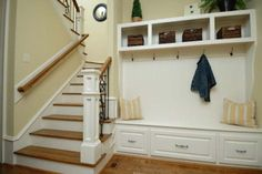 Entryway Bench with Storage, Stairs, Striped Pillow and Jacket