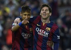 Barcelona forwards Neymar (L) and Lionel Messi (R) celebrate after scoring a goal during the Spanish league football match against Getafe at the Camp Nou stadium in Barcelona