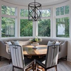 dining nook with bow window | Curved Bay Window - Love the bench.