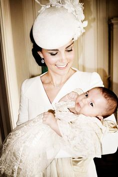 July 2015: Princess Charlotte Looks Adorable in her mother's arms.