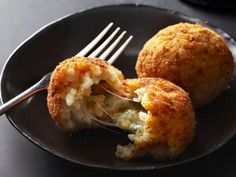 ARANCINI.* Break open these fried rice balls to find a melty, cheese-filled centre. Yum!