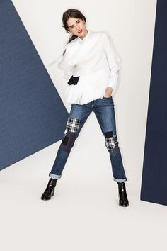 """In mix-and-match designs, patches are like the sartorial wink on your favorite new """"going-out"""" denim ensemble. Plus, when paired with an equally quirky top, like this super-swingy, fringed number (and its subtle fringe patch!), the whole look is ready for any party night...and, dance floor.Maki Oh top."""