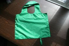 Simple ripstop grocery tote with snap closure built in for folding down and storage.