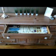 My clever mom helped me to transform the top drawer of my dresser into great jewelry storage and display. Just use foam & cut to fit. It holds your pieces in place! You can even cut slits for rings.
