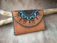 The design is burned on leather and painted with Leather color. Leather Stamps, Leather Art, Painting Leather, Handmade Wallets, Handmade Leather Wallet, Mandala Art, Leather Accessories, Pyrography, Leather Working