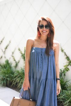 6bcd76f48018d Amy Havins wears a denim tiered maxi dress with flats | Dallas Wardrobe Blog  | maxi dresses, summer maxi dresses, denim maxi dresses, summer trends