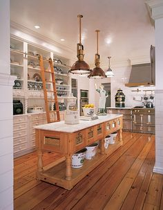 I love this kitchen! The kitchen island is in the same, rustic wood as the floors, the two pendants are great and I really like the mix of cabinets and open shelves. AND (one more thing) the light in this room is perfect