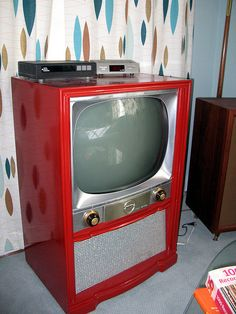 1954 RED TV -- and atomic wallpaper... my parents had a tv similar with a blonde wood cabinet when I was a baby!  Must have been a hand me down from my grandparents. Because I wasn't close to being born in 1954! lol