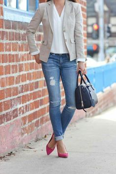 A casual look for work a simple pair of rip jeans with a white work-shirt, a blazer and red pumps to pop up the whole outfit.