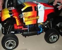 Hobby-Grade: Adding the body to a hobby-grade nitro RC car. © M. James