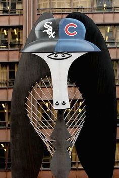 The Picasso statue wears the home team hats at the Play Ball Chicago festival in Daley Plaza.