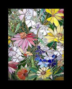 Not having garden space I am rather taken by these bright floral mosaics to add colour to our back yard