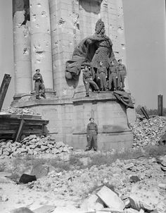 Canadian soldiers at war-damaged southern pylon of the Charlottenburg Gate, July 1945 Berlin