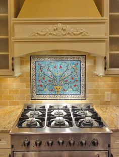 This is what I want to do with the tiles we brought back from Turkey!  Jerusalem Pottery - Pomegranate Tree Tile Mural
