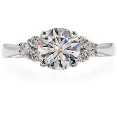 Grandeur Engagement Ring, The Hearts On Fire diamond solitaire is the actor on a sparkling stage with three Hearts On Fire diamonds on either side. This diamond engagement ring is available in platinum. 603-749-3129