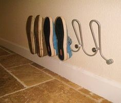 Coat hooks for shoe storage.