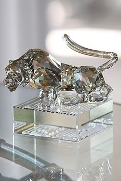 """Swarovski Zodiac Tiger   $300.00 3 11/16""""   Item# 1002980        2010 is the year of the tiger. A powerful Chinese Zodiac sign, the tiger stands for dynamism, charisma and vigour.  In faceted and unfaceted Silver Shade crystal, the tiger's eyes gleam in Moroda Sahara crystal. Its faceted clear crystal base, with an engraved matte finish, highlights the name of the zodiac in English and Chinese seal script.  Chinese astrology divides the 12 animals of the zodiac into four groups which…"""
