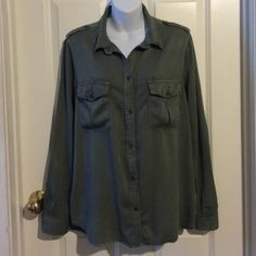 Olive Washed Boyfriend Fit Blouse This is a great top to pair with shorts or jeans. It has a soft, brushed fabric in a washed out soft olive color. Button pockets and army style shoulder ties. American Eagle Outfitters Tops Button Down Shirts