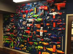 Top 10 Ways to Create a Jaw-Dropping Nerf Display. Ever wondered why some Nerf walls look better than others? Here are tried-and-true methods to making your Nerf display look incredible! Nerf Gun Storage, Toy Storage, Storage Ideas, Kids Storage, Storage Solutions, Kids Bedroom, Bedroom Decor, Gun Rooms, Nerf War