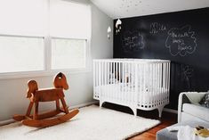We love this black and white nursery with the chalkboard wall. #nursery