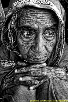 Stunning portrait, old woman, hands, fingers, wisdom, wise, lines of life, cracks in time, wrinckles, aged, weathered, expression, powerful face, intense, strong, portrait, photo b/w.