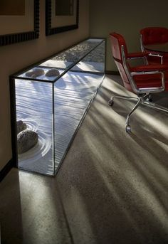 Stage calm, grounded meetings with an encapsulated Zen garden and dappled sunlight to support focus & cooperation.