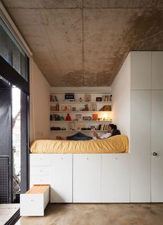 9 Ideas For Under-The-Bed Storage // This bed takes built in storage to a whole new level. Drawers, cupboards, and shelves all surround this bed, making it the perfect spot to store all your things.