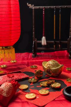 Something with Chinese lunar New Year elements. Gold ingots and couplets with th , Chinese Buddhism, Lunar New, Red Aesthetic, Gold Coins, Feng Shui, Traditional, Stock Photos, Table Decorations, Holiday Decor