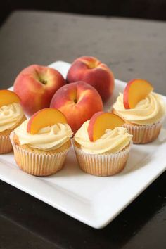 Peach cupcakes with peach cream cheese frosting. I need to make these before summer is gone. Peach Cupcakes With Peach Cream Cheese Frosting: Makes 24 cupcakes The perfect thing to eat with your fingers, and perfectly summery. Köstliche Desserts, Delicious Desserts, Dessert Recipes, Yummy Food, Tasty, Summer Cupcake Recipes, Recipes Dinner, Wedding Cupcake Recipes, Dessert Healthy