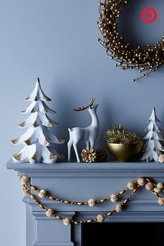 Tis the season for festive gold and white décor. Love this modern mantle.
