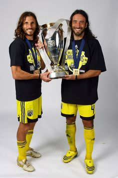 Captain Frankie Hejduk #2 and Gino Padula #4 of the Columbus Crew pose for a post-game celebration portrait with the Philip F. Anschutz trophy after defeating the New York Red Bulls to win the 2008 MLS Cup match at The Home Depot Center on November 23, 2008 in Carson, California.