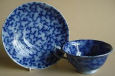 ANTIQUE FLOW BLUE POTTERY STAFFORDSHIRE CUP & SAUCER HACKWOOD BERRY PATTERN