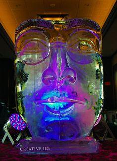 Large scale ice sculpture of John Lennon's face.